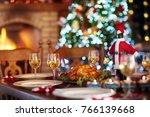 christmas dinner at fireplace... | Shutterstock . vector #766139668