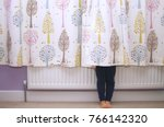 young girl hiding behind a... | Shutterstock . vector #766142320