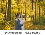 the bride and groom on the... | Shutterstock . vector #766150258