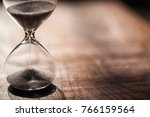 hourglass as time passing... | Shutterstock . vector #766159564