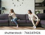 young couple arguing sitting on ... | Shutterstock . vector #766165426