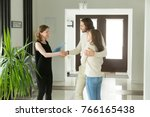 friendly realtor and young... | Shutterstock . vector #766165438