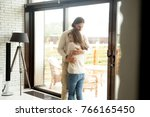 young man and woman hugging... | Shutterstock . vector #766165450