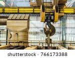 Small photo of Steel hook of overhead crane over industrial equipment