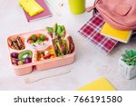 open lunch box with healthy... | Shutterstock . vector #766191580