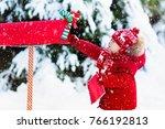 happy child in knitted reindeer ... | Shutterstock . vector #766192813