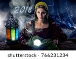 Small photo of Female fortune teller doing a psychic reading with a cystal ball predicting fate or destiny and the future of the year 2018