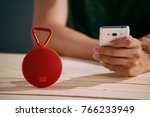 red wireless speaker on wooden...   Shutterstock . vector #766233949