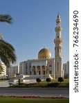 Small photo of MUSCAT, OMAN, FEBRUARY 18, 2013. The beautiful Al-Zawawi Mosque sits tranquilly amid hotels, apartment buildings, and businesses in Muscat. Oman.