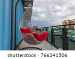 white hanging chair with red... | Shutterstock . vector #766241506