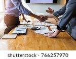 business people shaking hands ...   Shutterstock . vector #766257970