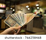 closeup hand man holding money... | Shutterstock . vector #766258468