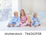 kids playing in parents bed in... | Shutterstock . vector #766262938