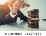 businessman domino picked some... | Shutterstock . vector #766277839