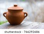 Empty Clay Pot On A Wooden...