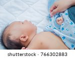 shot of young mother changing... | Shutterstock . vector #766302883