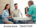 a dentist discussing the... | Shutterstock . vector #766317439