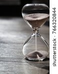 hourglass as time passing... | Shutterstock . vector #766320844