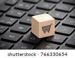 wooden block with shopping cart ... | Shutterstock . vector #766330654