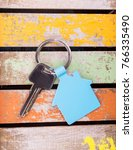 house key on wooden background | Shutterstock . vector #766335490
