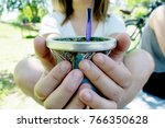 adult woman offering yerba mate ... | Shutterstock . vector #766350628