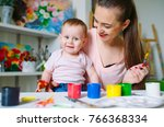 mom and daughter paint on... | Shutterstock . vector #766368334
