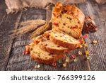 fruit cake on wood | Shutterstock . vector #766399126