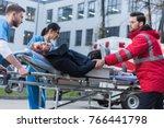 doctors moving injured man on... | Shutterstock . vector #766441798
