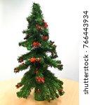 christmas tree on table. | Shutterstock . vector #766443934