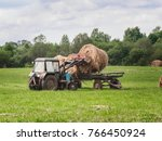 Single Tractor Is Picking Up...