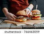 cropped view of girl in apron... | Shutterstock . vector #766463059