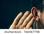 Small photo of Businessman trying to hear a gossip