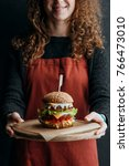 cropped view of girl in apron... | Shutterstock . vector #766473010