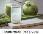 coconut juice on wooden board... | Shutterstock . vector #766477843