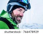 Portrait Of  Happy Male Skier...