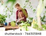 botany. woman florist grows... | Shutterstock . vector #766505848