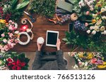cropped image of florist... | Shutterstock . vector #766513126