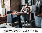 handsome caucasian grey haired... | Shutterstock . vector #766521616