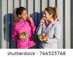two sporty women on fitness... | Shutterstock . vector #766525768