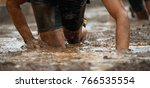 mud race runners.crawling... | Shutterstock . vector #766535554