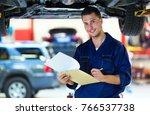 car mechanic in workshop | Shutterstock . vector #766537738