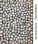 Small photo of Texture of pebbles attached to the surface of a floor in front of a shop located in Perak, Malaysia.