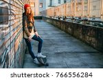 young  and beautiful skater... | Shutterstock . vector #766556284