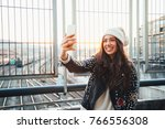 happy young woman taking a... | Shutterstock . vector #766556308