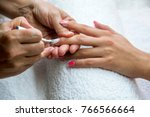 beautician applying red varnish ... | Shutterstock . vector #766566664