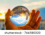 a hand holding a crystal ball... | Shutterstock . vector #766580320