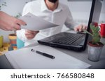 man in the office  giving paper | Shutterstock . vector #766580848