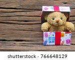 Cute Teddy Bear In Gift Box On...