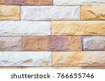 bring the stone to a wall. | Shutterstock . vector #766655746