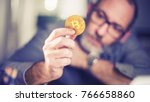 bitcoins   bitcoin in hand of a ... | Shutterstock . vector #766658860